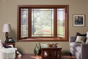 A bay window with a wood frame and decorative grids.