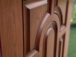 Closeup of a fiberglass front dooe with the look of natural wood