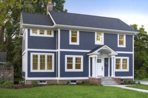 Dark blue vinyl siding on a home's exterior