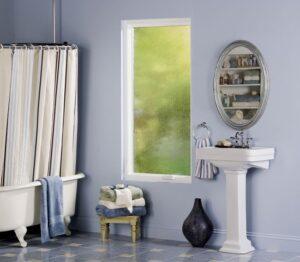 A white casement window in a bathroom